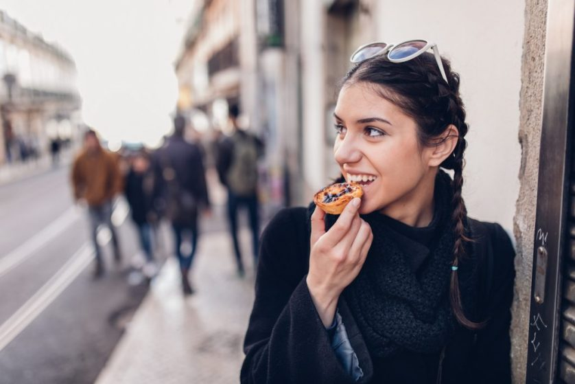 Tourist eating local food in Portugal
