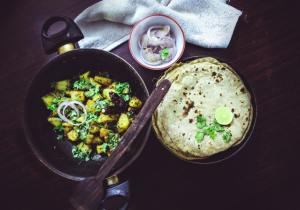 Baked roti - one of the dishes you must try when traveling to India