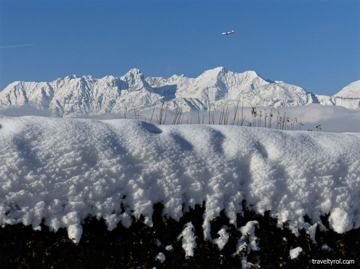Snow-capped mountains as Innsbruck flights arrive in Tyrol in winter.