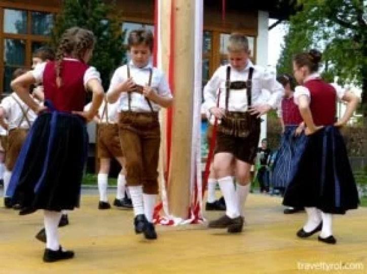 Children dancing around a Maypole in Austria.
