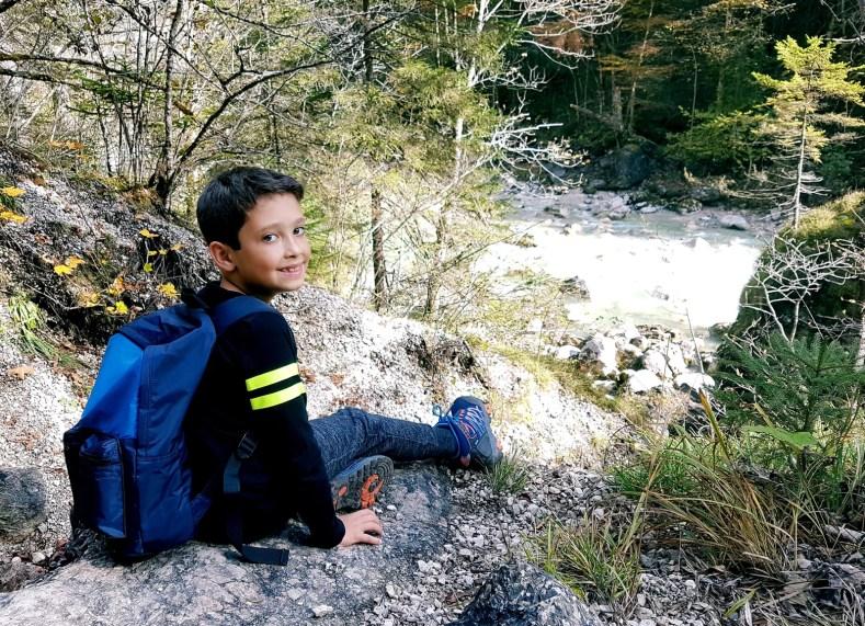 Kid enjoying view on Tiefenbachklamm hike in Austria.