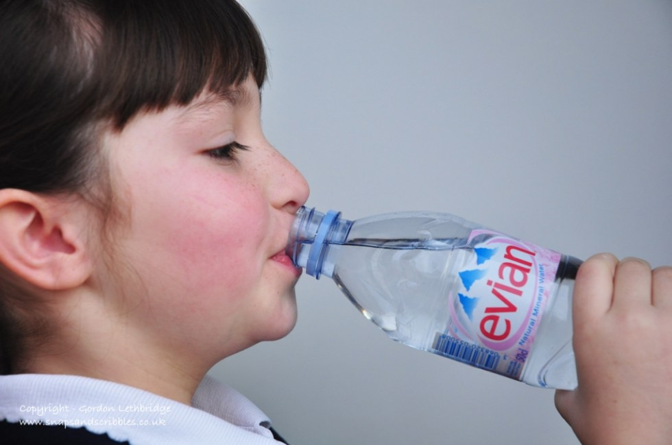Evian water and child