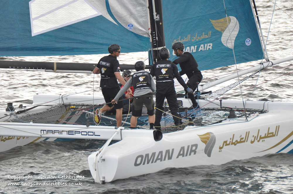 Action on board the Oman Air Boat as they race close inshore