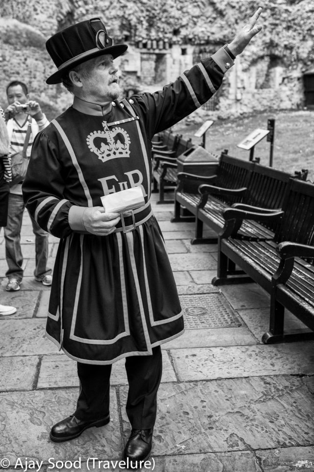 Beefeater pointing out the Crown Jewels Vault