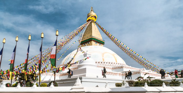 The all-seeing eyes painted on the four sides on the base of the spire symbolise awareness, and their gaze follows you as you go around its perimeter soaking in the bustle and belief. - Boudhanath Kathmandu - The Largest Stupa in Nepal - Travelure ©