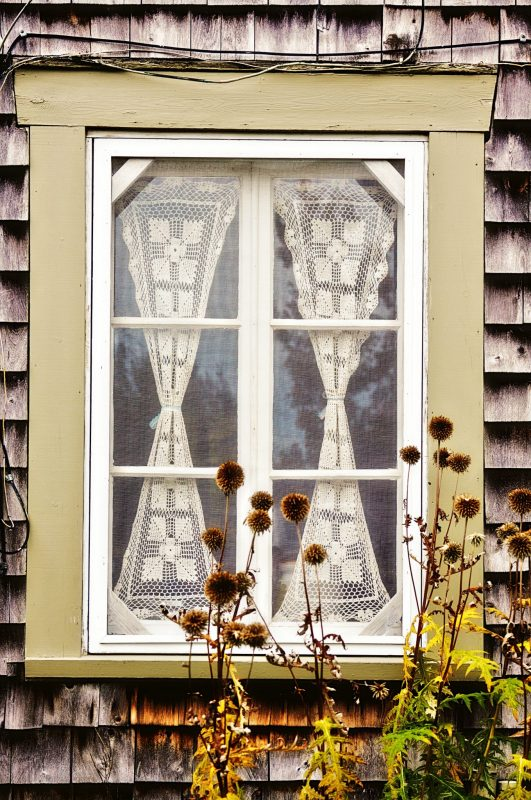 Framed lace window in Quebec, Canada