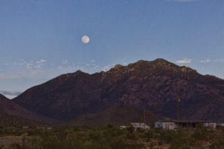 Full solstice moon over Cerbat Mountains in Dolan Springs, Mohave Desert, Arizona