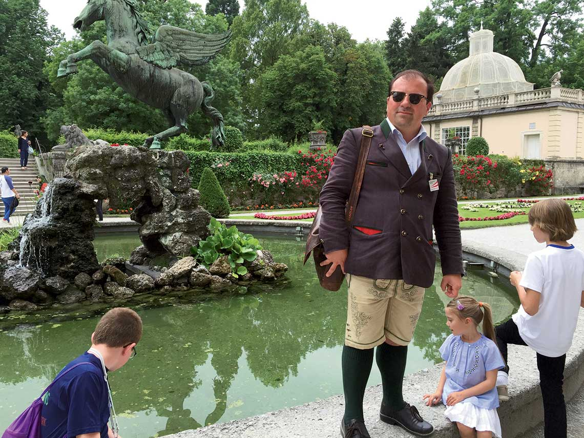 "Baron Peter von Wethelm, a Salzburg tour guide and relative of the Von Trapp family on which ""The Sound of Music"" was based, points out a fountain featured in the ""Do-Re-Mi"" scene."