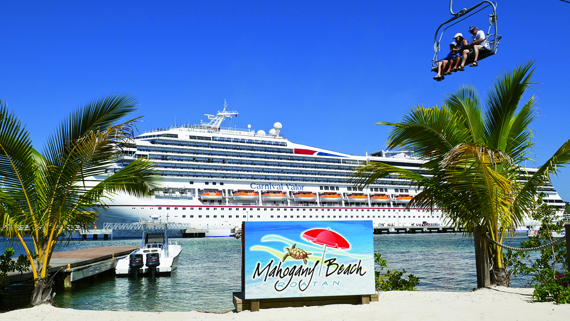 Carnival Cruise Line, which plans to build a beach destination on Grand Bahama island, already has a custom-built port at the island of Roatan in Honduras. Photo Credit: TW photo by Tom Stieghorst