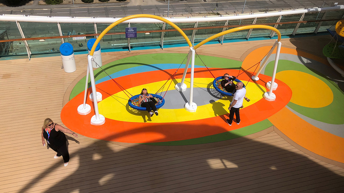 New swing chairs on the Independence of the Seas were part of a $110 million overhaul. Photo Credit: Tom Stieghorst