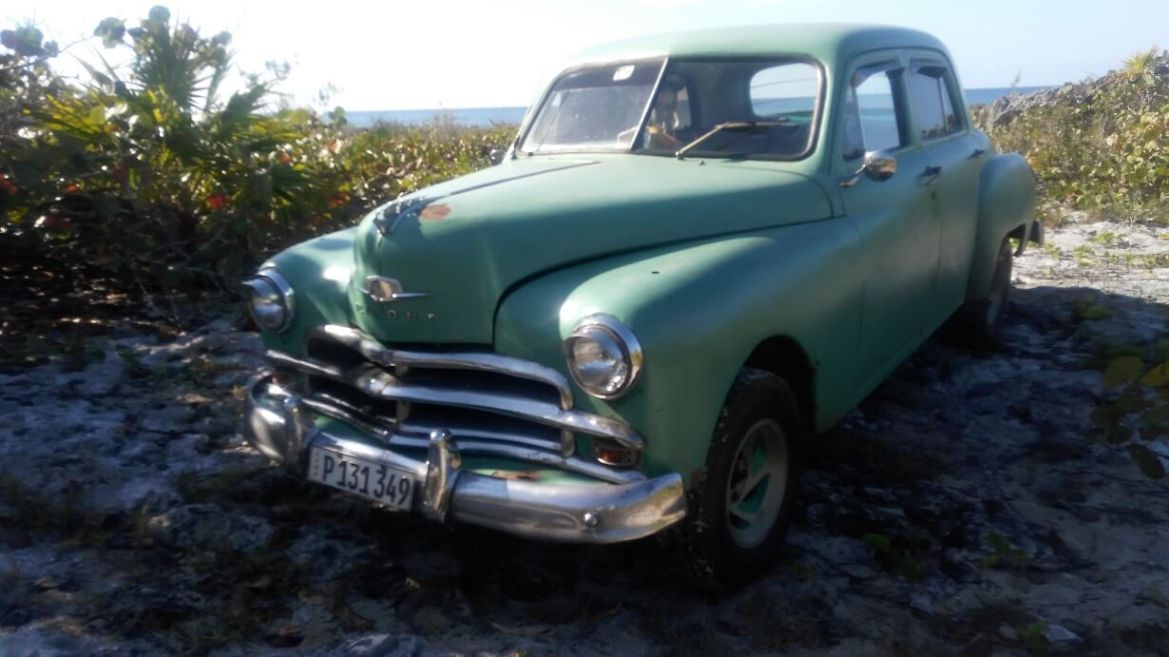 Vintage car on the way from Caleta Buena to Playa Giron, Bay of Pigs, Cuba