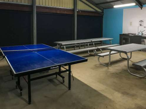 Table Tennis and tables inside camp kitchen at Big4 Port Willunga Tourist Park