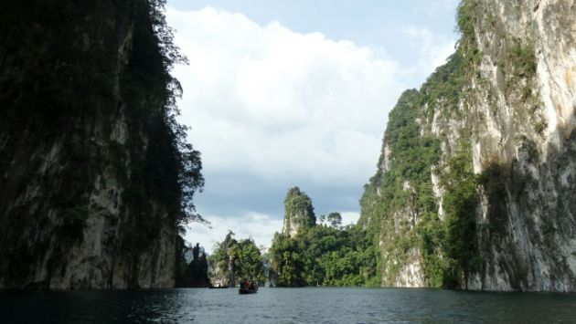 Towering limestone cliffs emerging out of the lake