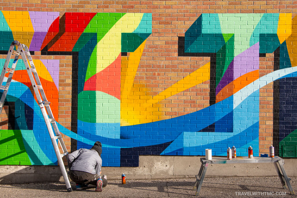 Steph Boutari putting the finishing touches on her colourful St Jacobs mural