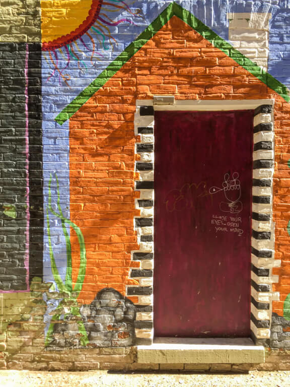 Travel with TMc in Owen Sound's Urban Art Alley Project