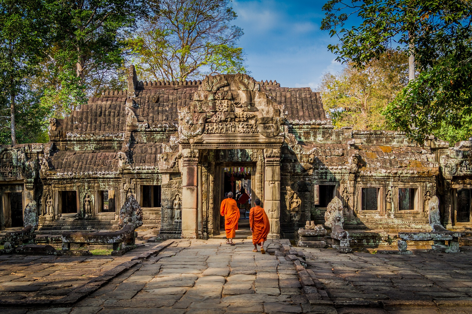 Monks being taught English in Cambodia, leaving an Angkor temple.