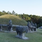Traditional Korean tombs look like hills of grass with ornaments depending on the importance of the person buried.