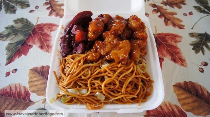 Chow mein, BBQ pork (left), and orange chicken (right)