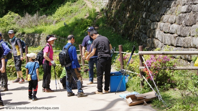 This guy selling walking sticks at the foot of the mountain is the best salesman in Korea.