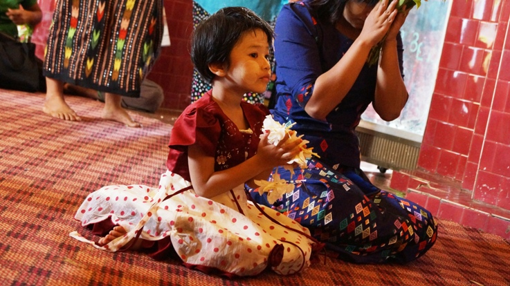 Burmese girl praying
