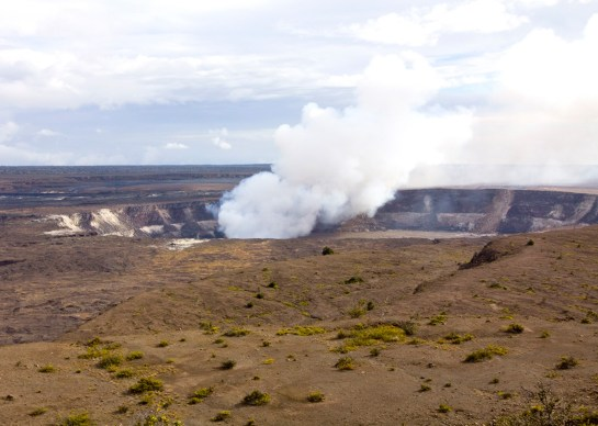 Volcanic gases billow from Halema'uma'u Crater in the giant Kilauea Caldera, Hawaii Volcanoes National Park, Big Island, Hawaii.