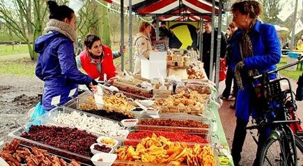 Goodies from around the world at stalls along Damrak Amsterdam