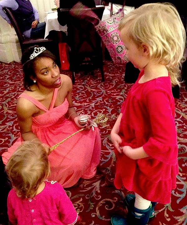 girls meet Christmas fairy at Macy's Walnut Room