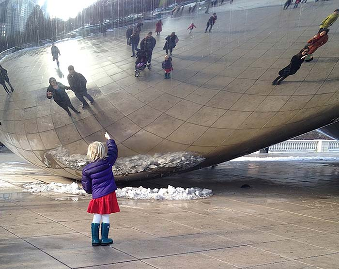 granddaughter under the Cloud Gate sculpture