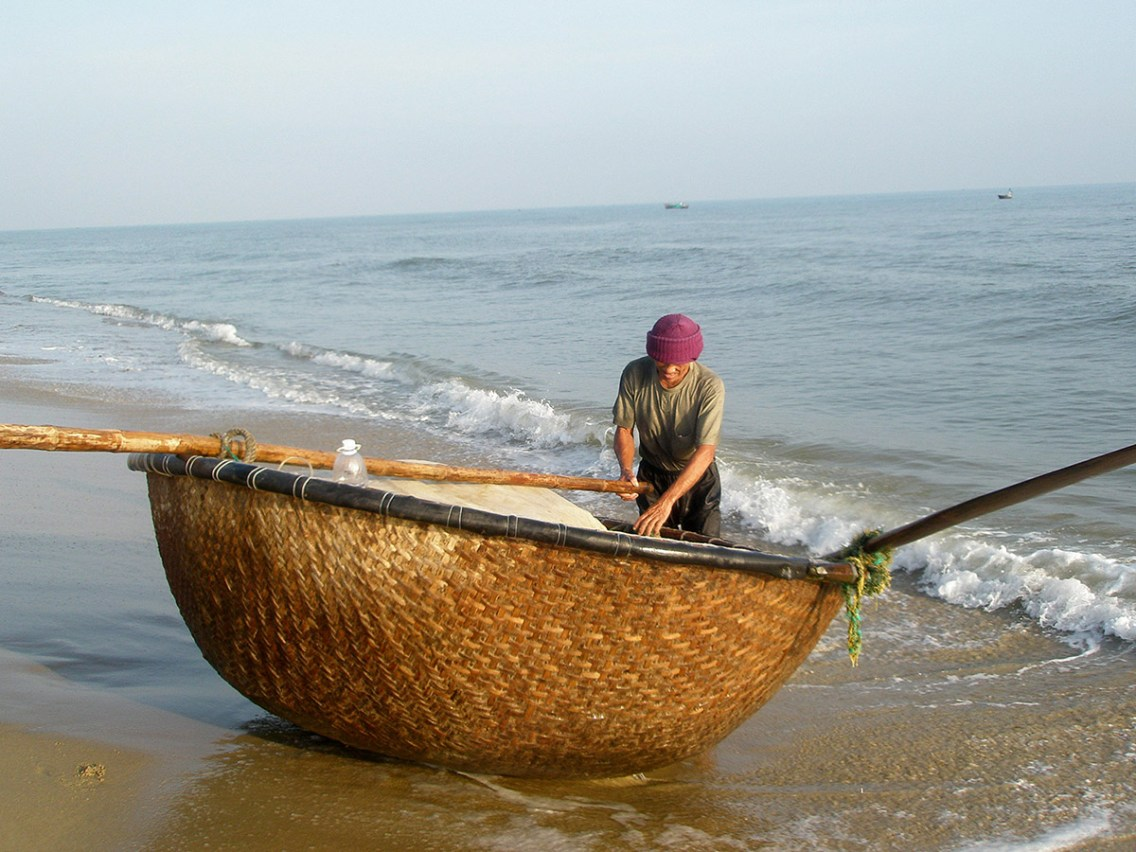 Fisherman with traditional style boat