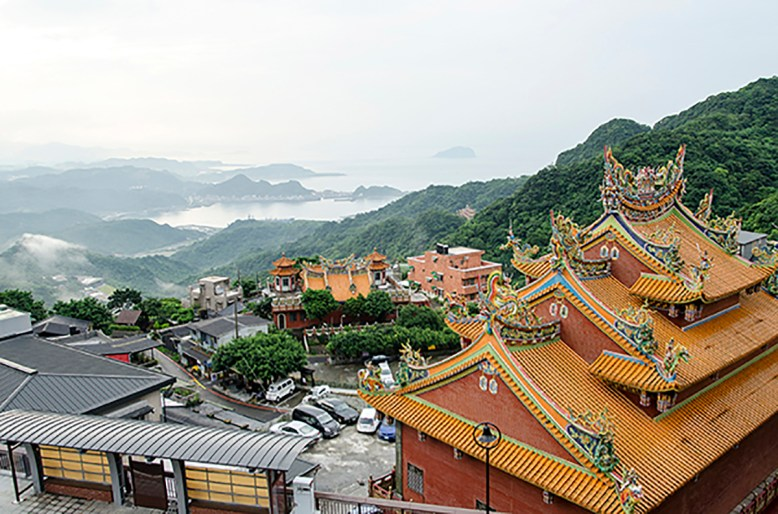 Looking north at the South China Sea over the roof of the Fushan Temple from the mountains at Juifen where gold miners enriched the area long before it became a tourist Mecca.