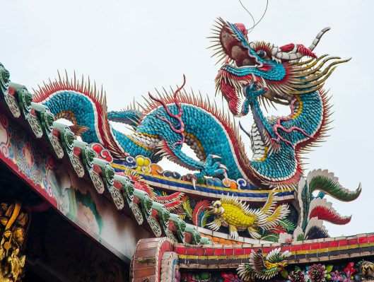 Exotic and elaborately crafted dragons guard the Longshan Temple from evil spirits.