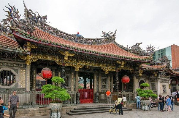 The Mengjia Longshan Temple in Taipei's Wanhua District dates from 1738. From the street, it is unassuming, concealing a crush of worshipers inside.
