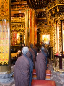 Monks at Longshan Temple in Taipei paying homage to Buddha.