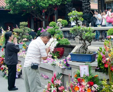 Taiwan's people regularly go to local temples to worship, petition the pantheon for help, seek comfort in the midst of life's challenges. Here, worshipers take an afternoon break at Taipei's Longshan Temple.