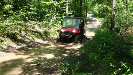 UTV in a muddy spot on the trail. Photo Credit: Linda Askomitis