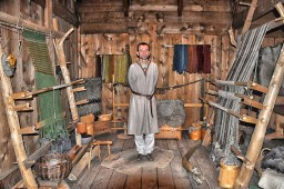 Lofoten Islands: Viking Museum-interpreter in weaving room at Viking longhouse. Photo credit: Jennifer Crites