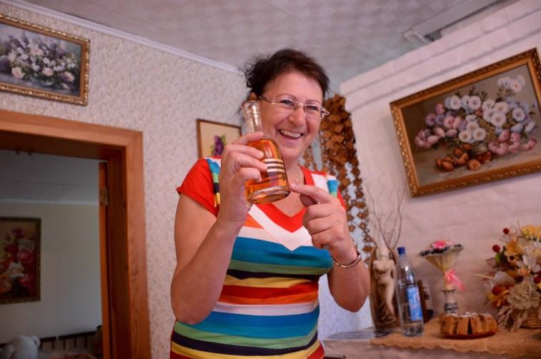 Elizaveta, our hostess serving vodka. Photo credit: Kristin Winet