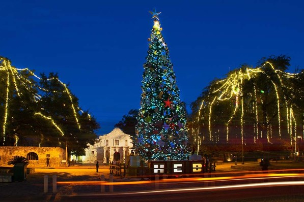 A Christmas tree and holiday lights frame teh iconic Alamo. Photo Credit: VisitSanAntonio.com