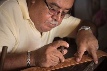 Rom·n Meza of La Regional Talabarteria working on leather piece in his shop in the Pitillal district of Puerto Vallarta, Jalisco, Mexico.