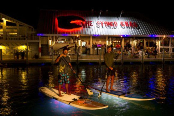 Two men Night Paddleboarding on Ibis Bay