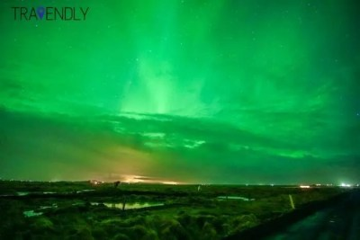 Green sky from the Northern Lights in Iceland countryside