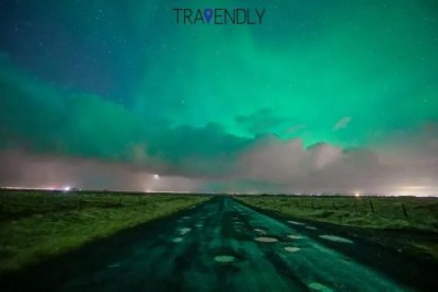 Countryside road under Northern Lights in Iceland
