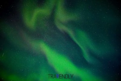 Sky view of Northern Lights in Iceland with satellite streak