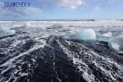 Icebergs on a black sand beach near Jokulsarlon lagoon Iceland