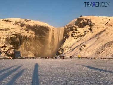 Skogafoss waterfall with light snow cover