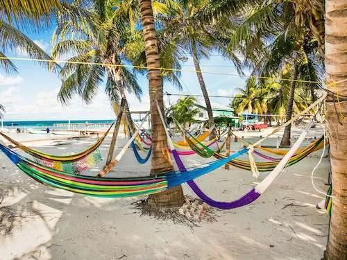 Belize group travel relaxing in hammocks