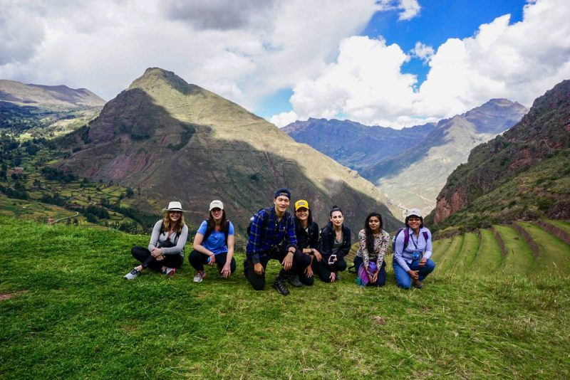 Taking a knee at the Pisac ruins in Peru