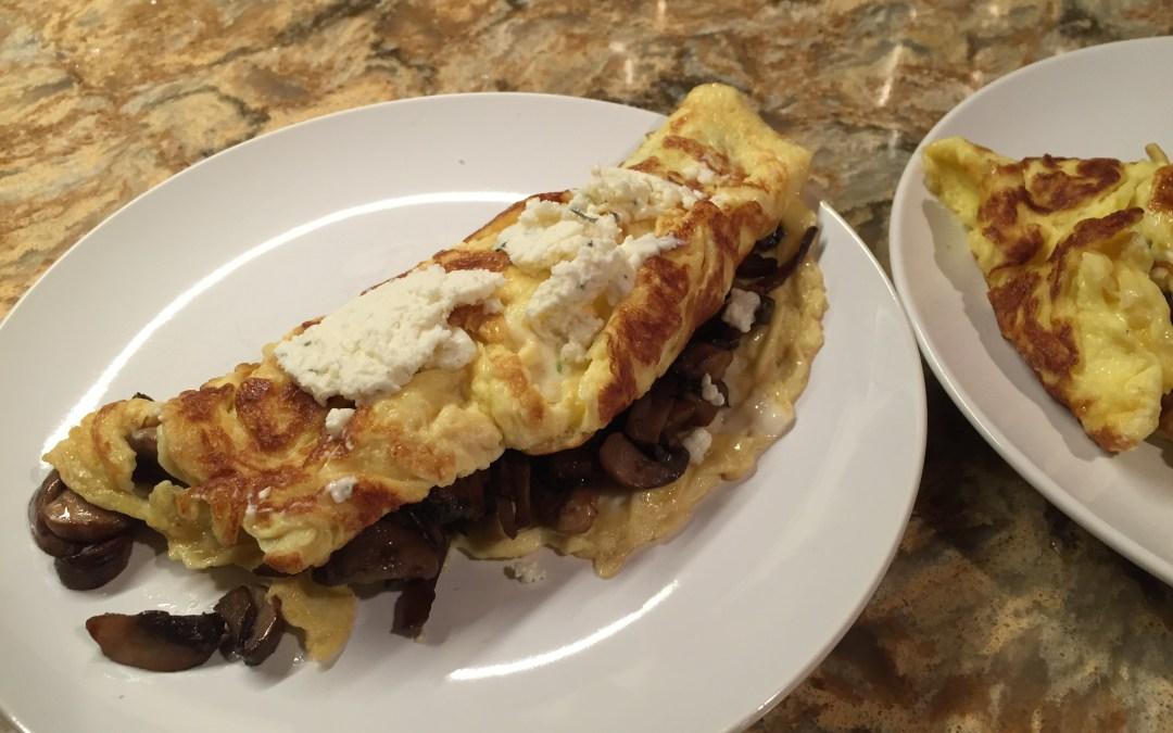 Not Paleo, but dang good Cheesy Mushroom Omelettes