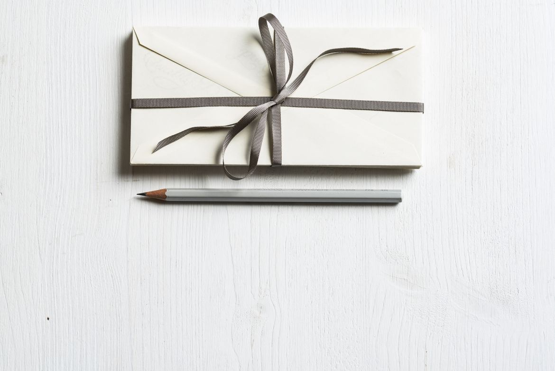 Bundle of envelopes with grey pencil