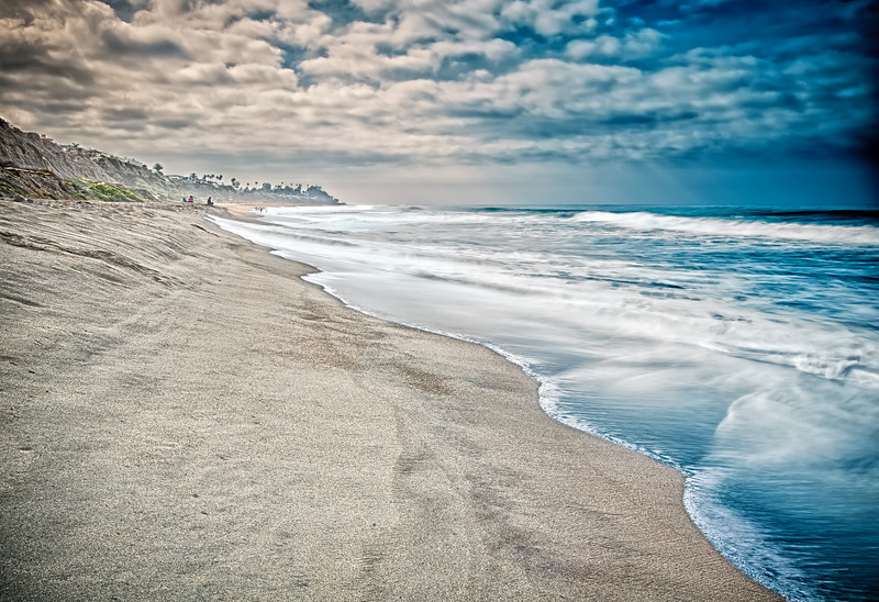 One morning on the San Clemente State Beach in April 2015 the storm from the ocean confronted the bright morning sun and seemed to receed back over the ocean. The waves of the Pacific knawed at the sunlit sands like long worn teeth.
